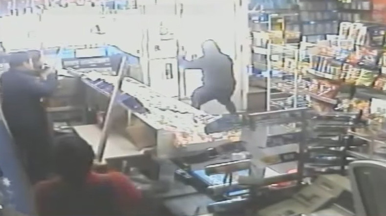 Armed shopkeepers chase attempted robber out of store (VIDEO)