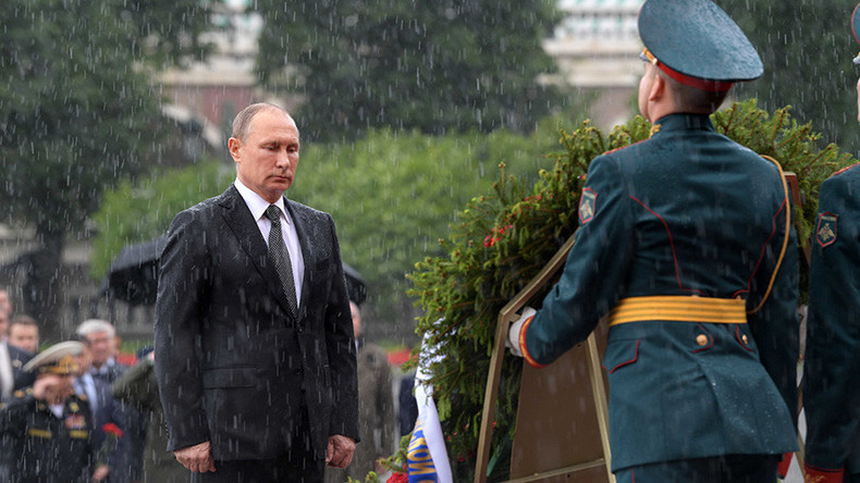 'Not made of sugar': Putin shrugs off badass downpour pic