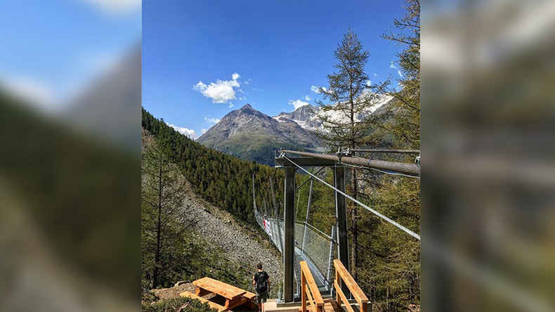 Hikers brave 'world's longest' suspension bridge above Swiss ravine (VIDEO)
