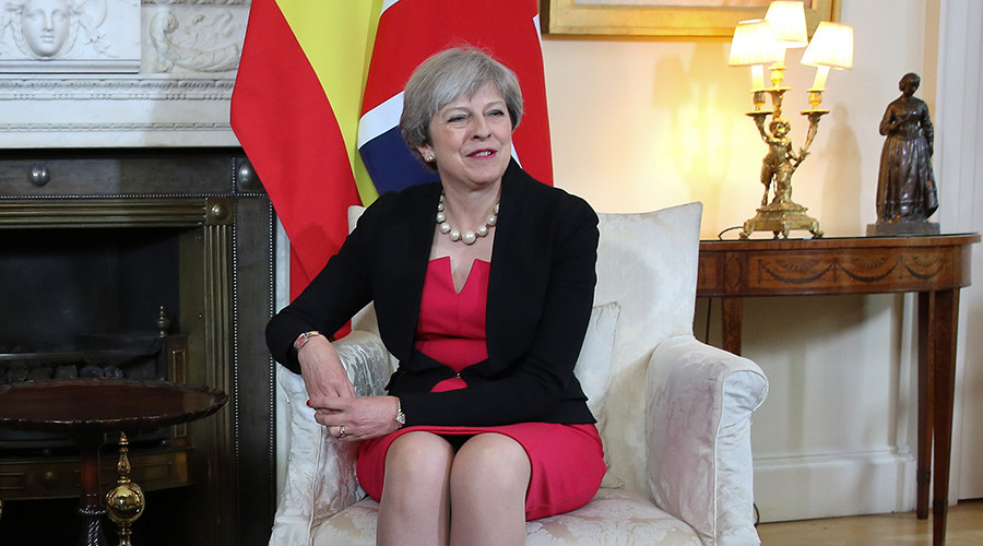 Romanian journalist confronts awkward Theresa May over Brexit at swanky party (VIDEO)