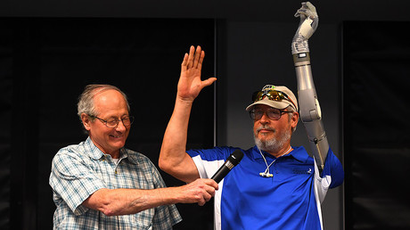 US Army veteran Fred Downs smiles as US Army Veteran Artie McAuley(R) is shown with his LUKE prosthetic arm, New York June 30, 2017. ©