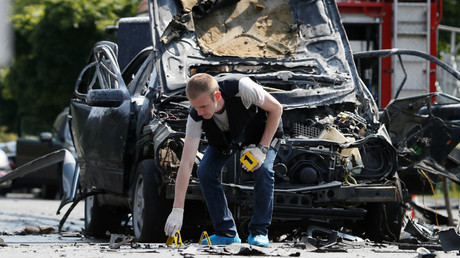 An investigator works at the scene of a car bomb explosion which killed Maxim Shapoval, a high-ranking official involved in military intelligence, in Kiev, Ukraine, June 27, 2017. © Valentyn Ogirenko