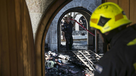 An Israeli police officer surveys the scene of a fire at the Church of Loaves and Fishes on the shores of the Sea of Galilee in northern Israel June 18, 2015. © Baz Ratner