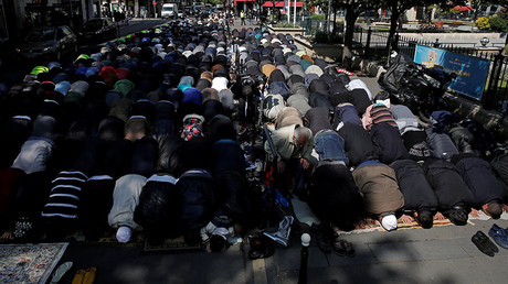 Muslims pray during Friday prayers in the street in front of the city hall of Clichy, near Paris. © Benoit Tessier