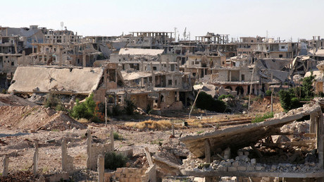 FILE PHOTO A general view shows damaged buildings in a rebel-held part of the southern city of Deraa, Syria © laa Al-Faqir