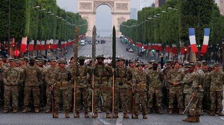 US troops, with soldiers wearing WWI helmets, walk on the Champs Elysees during a rehearsal of the traditional Bastille Day military parade in Paris, France, July 10, 2017. © Pascal Rossignol