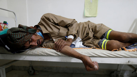 A man lies on the bed of a cholera treatment center in Sanaa, Yemen, May 15, 2017. © Khaled Abdullah