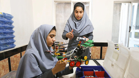 Members of Afghan robotics girls team work on their robots in Herat province, Afghanistan July 4, 2017 © Mohammad Shoib
