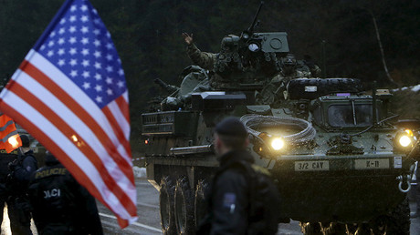 DATE IMPORTED:March 29, 2015A soldier of the U.S. Army waves as he arrives in the Czech Republic during the