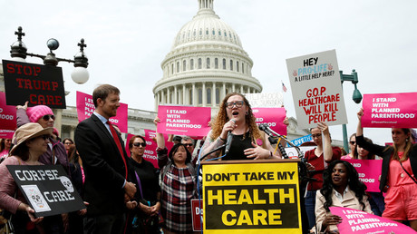 FILE PHOTO Protesters rally during U.S. House voting on the American Health Care Act © Yuri Gripas