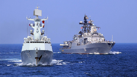 FILE PHOTO: Chinese frigate ''Huangshan'' and Russian Navy's Antisubmarine Ship ''Admiral Tributs'' during a China-Russia naval joint drill at sea off south China's Guangdong Province. © Zha Chunming / Global Look Press