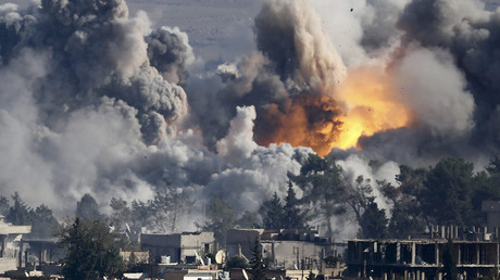FILE PHOTO: Smoke rises over Syrian town of Kobani after an airstrike. A U.S.-led military coalition has been bombing Islamic State © Kai Pfaffenbach