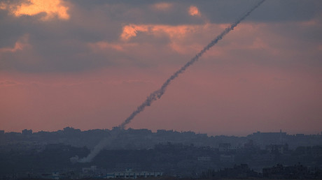 FILE PHOTO: Smoke trails are seen as rockets are launched from the Gaza Strip towards Israel as seen from the Israeli border © Amir Cohen