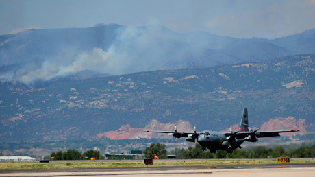 A US Air Force C-130 on a firefighting mission lands at Peterson Air Force Base in Colorado in this 2012 file photo © Christian Murdock / Global Look Press