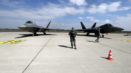FILE PHOTO U.S. Army soldiers guard as U.S. Air Force F-22 Raptor fighters are parked in the military air base in Siauliai, Lithuania © Ints Kalnins