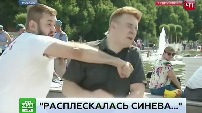 Rowdy Moscow reveler ruins live report by punching correspondent in the face (VIDEO)