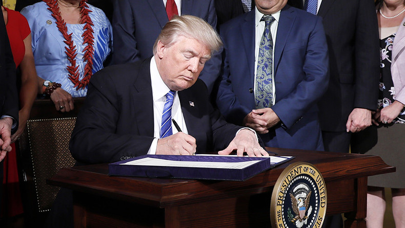 Trump signs Russia sanctions bill despite 'clearly unconstitutional' provisions