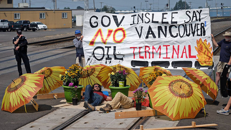 2 protesters arrested after laying down on tracks to block oil train in Washington