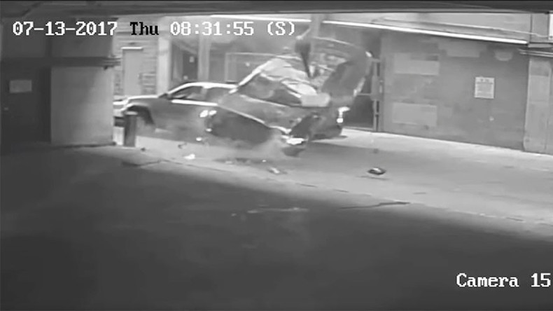 Car plunges 7 stories through barrier of parking lot (VIDEO)