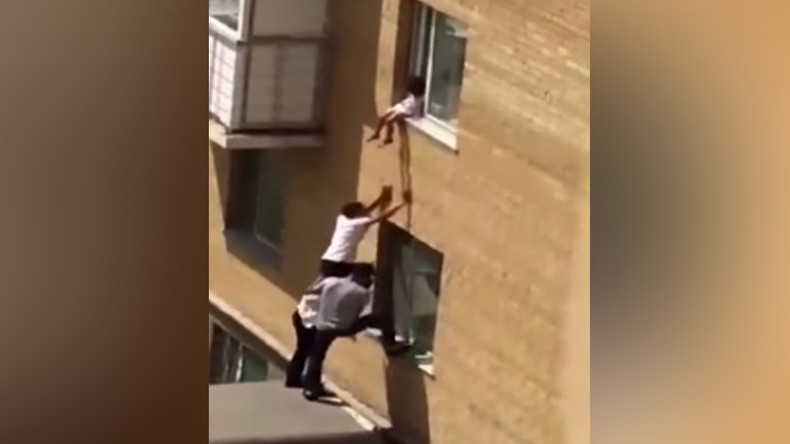 3 men form human pyramid to save toddler from perilous fall (VIDEO)