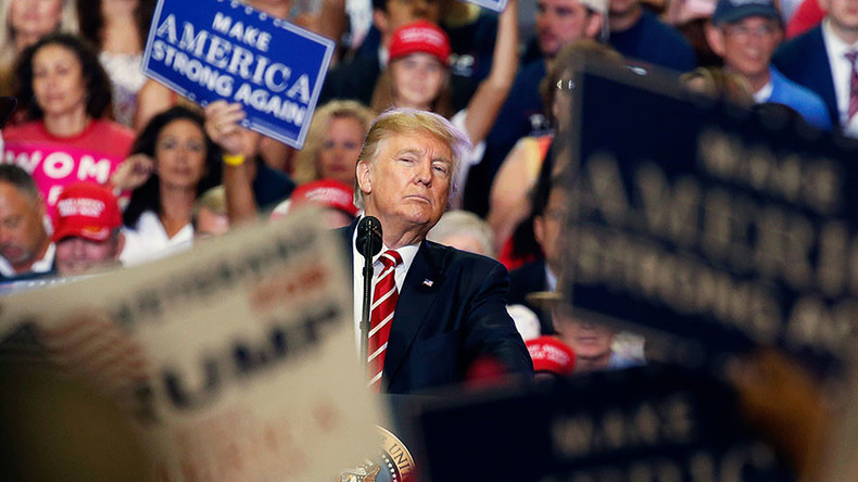 Unrepentant Trump fires back at media over Charlottesville, hints at Arpaio pardon in Phoenix