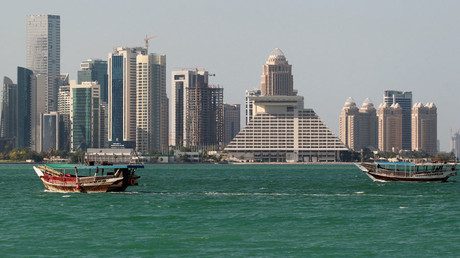 Buildings are seen on a coast line in Doha, Qatar © Naseem Zeitoon
