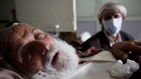 FILE PHOTO: An old man infected with cholera lies on the bed at a hospital in Sanaa, Yemen © Mohamed al-Sayaghi