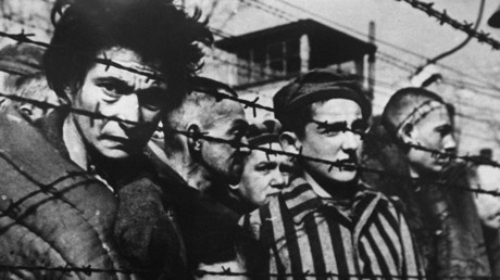 A picture of inmates behind barbed wire taken in 1945 when the concentration camp of Auschwitz was liberated in Poland where millions of Jewish deportees were exterminated by nazis during World War II. © Elizaveta Svilova