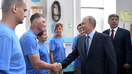 Russian President Vladimir Putin during a meeting with volunteers of the Great Baikal Trail public organisation at the Baikal Reserve visitor center  August 3, 2017. 