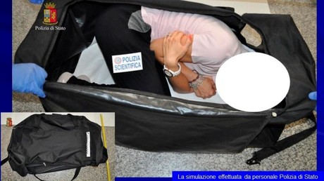 A person taking part in a reenactment by Italian police shows how a kidnapped British model was kept in a bag, in this handout picture provided by the Italian Police in Milan on August 5, 2017. © Polizia Di Stato