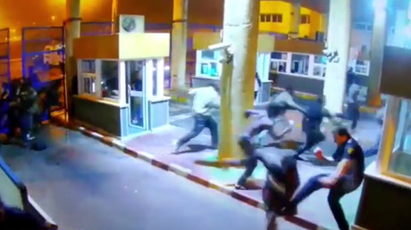 Spanish border guard suffers horrific leg break tackling migrant (VIDEO)