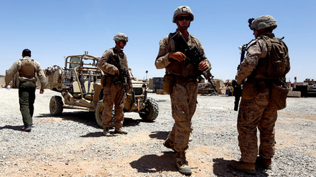 U.S. Marines walk inside their base after they are back from training with Afghan National Army (ANA) soldiers in Helmand province, Afghanistan © Omar Sobhani