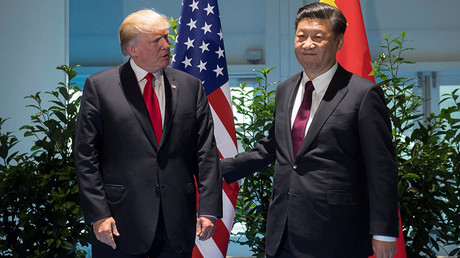 US President Donald Trump and Chinese President Xi Jinping (R) © Saul Loeb