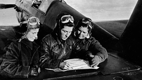 Female pilots of the 586th regiment: Litvyak, Budanova and Kuznetsova (left to right) near the YaK-1 aircraft © Sputnik