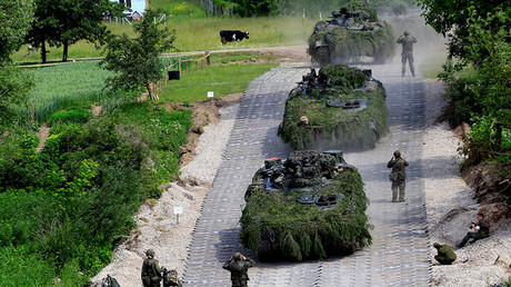 German Army Leopard tanks cross the Neris river during the 2017 Iron Wolf exercise in Stasenai, Lithuania, June 20, 2017. © Ints Kalnins