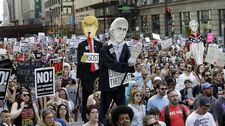 Demonstrators carry effigies of President Donald Trump and Vice President Mike Pence during a protest against hate, white supremacy groups on Sunday, August 13, 2017 in Chicago, Illinois. © Joshua Lott
