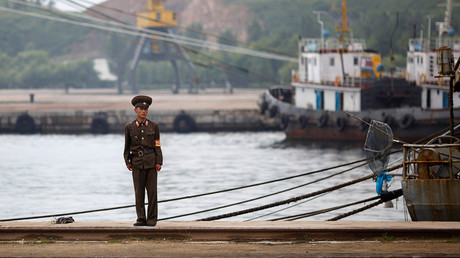 A soldier guards an area of Rason's city port in the North Korean special economic zone, northeast of Pyongyang. August 30, 2011 © Carlos Barria