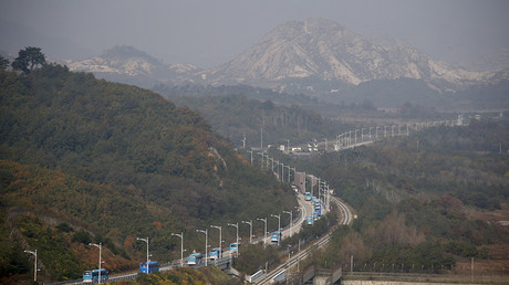 Buses transporting South Korean participants for reunion travel on road leading to North Korea's Mount Kumgang resort, in DMZ separating two Koreas in picture taken from the Unification Observatory, Goseong, South Korea © Kim Hong-Ji