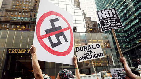 Protesters wave anti-Trump signs during protests in front of Trump Tower in New York City, New York, U.S., August 14, 2017 © Shannon Stapleton