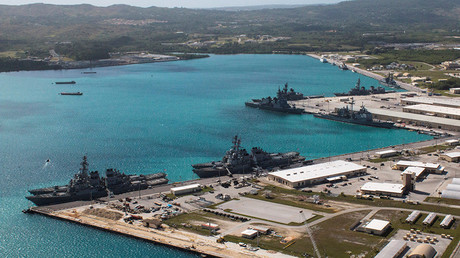 Navy vessels are moored in port at the U.S. Naval Base Guam at Apra Harbor, Guam © Naval Base Guam