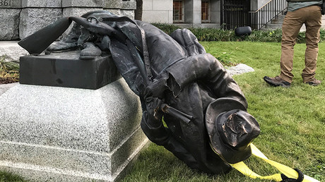 The toppled statue of a Confederate soldier in front of the old Durham County Courthouse in Durham © Kate Medley