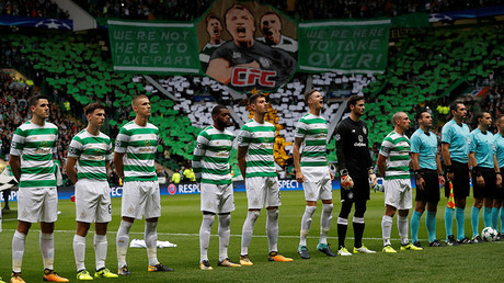 Celtic players line up before the match © Russell Cheyne
