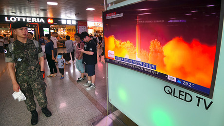 A South Korean soldier watches a video footage of North Korea's launch of an intercontinental ballistic missile, at a railway station in Seoul © Jung Yeon-Je / AFP