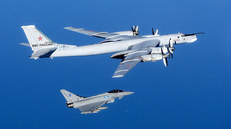 A Russian Tu-95 Bear bomber aircraft is escorted by a Royal Air Force Quick Reaction Alert (QRA) Typhoon during an intercept in September 2014 in the UK's Northern airspace. © RAF / Global Look Press