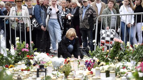Candles and flowers are left at the makeshift memorial by well wishers for the victims of stabbings at the Turku Market Square, Finland on August 19, 2017. ©  Vesa Moilanen / Lehtikuva