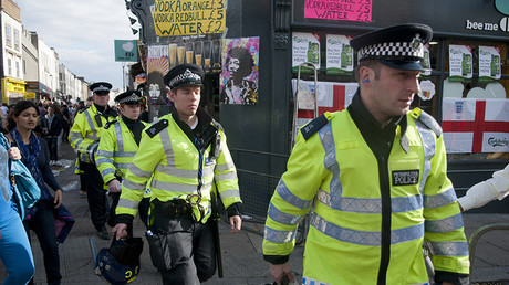 FILE PHOTO: Police walking to their command centre during the Notting Hill Carnival. © l94 / Global Look Press