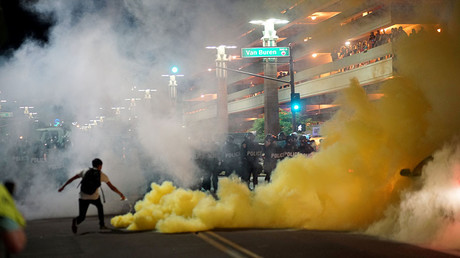 Police officials lob tear gas to try and disperse demonstrators after a Donald Trump campaign rally in Phoenix, Arizona, U.S. August 22, 2017. © Sandy Huffaker