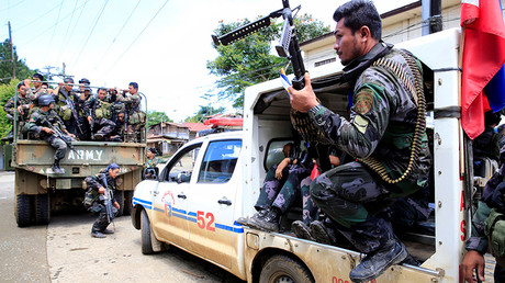 PNP Special Action Force member onboard a military truck in Marawi © Romeo Ranoco