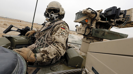 FILE PHOTO: A German Bundeswehr armed forces soldier looks out from a Boxer armoured personnel carrier at camp Marmal near Mazar-e-Sharif, northern Afghanistan. © Fabrizio Bensch