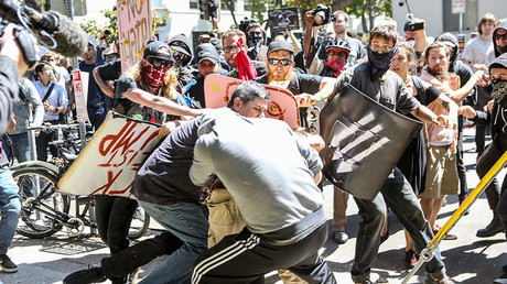No-To-Marxism rally members and counter protesters clash on August 27, 2017 at Martin Luther King Park Jr. Civic Center Park in Berkeley, California. © Amy Osborne